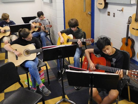 Guitar class strikes a chord with Raa students