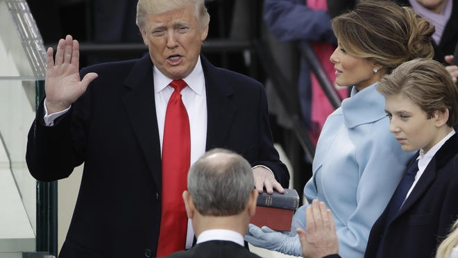 Matt Rourke/APDonald Trump is sworn in as the 45th president of the United States by Supreme Court Chief Justice John Roberts as Trump's wife, Melania, looks on Friday in Washington. Peaceful transfer of power is one of the hallmarks of our democracy. Donald Trump is sworn in as the 45th president of the United States by Chief Justice John Roberts as Melania Trump looks on during the 58th Presidential Inauguration at the U.S. Capitol in Washington, Friday, Jan. 20, 2017. (AP Photo/Matt Rourke) '
