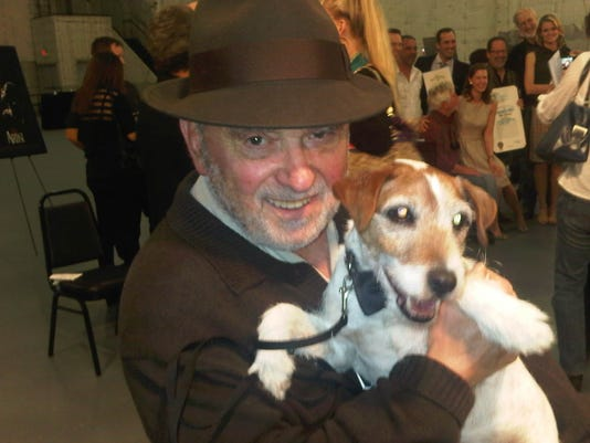 636177572076907096-1.-A-rare-photo-of-Dick-Guttman-and-a-client---Uggie-the-dog-from-The-Artist-in-2011-which-Guttman-did-press-for.-Provided-by-Dick-Guttman.jpg