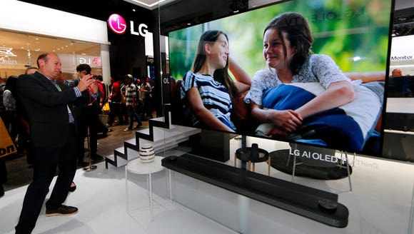 CES 2018 attendees view the LG signature OLED 4K HDR