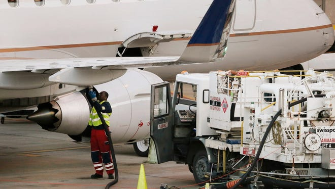 A worker prepares to fuel a United Express aircraft at Dallas/Fort Worth International Airport on Jan. 15, 2015.