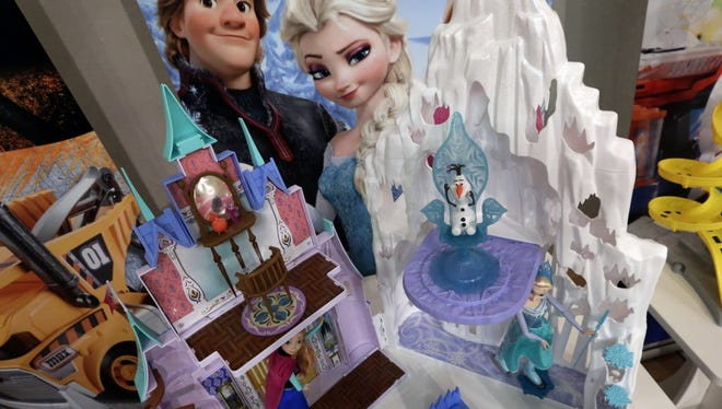 This Oct. 1, 2014 photo shows Disney's Frozen Castle & Ice Palace Playset at the TTPM Holiday Showcase, in New York. Toy sellers aim to perk up sales that were flat last year, though they hope to get a boost this year from toys related to ìFrozenî and the Teenage Mutant Ninja Turtles, which could sell out quickly. (AP Photo/Richard Drew) ORG XMIT: NYBZ105