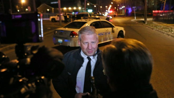 St. Louis Police Chief Sam Dotson addresses the media as police investigate a scene in which a 19-year-old passenger in a stolen car was fatally shot when he got out holding a gun and confronted two officers late Wednesday Jan. 21, 2015.