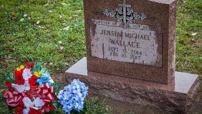 A headstone was placed at Jensen Michael's grave site by Elm Ridge Cemetery Friday.