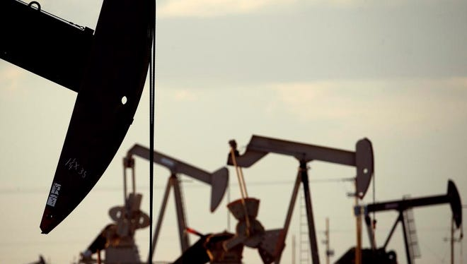 Pumpjacks near Lovington, New Mexico. A prolonged downturn in oil and natural gas markets continues to ripple through New Mexico's economy undermining state tax revenues.