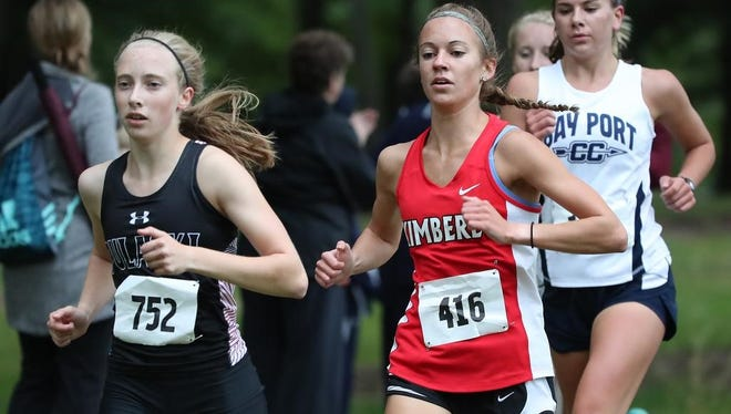 Annika Linzmeier of Pulaski, left, and Olivia Eisch of Kimberly lead the pack Thursday during the Southwest Invitational cross country meet in Colburn Park in Green Bay.
