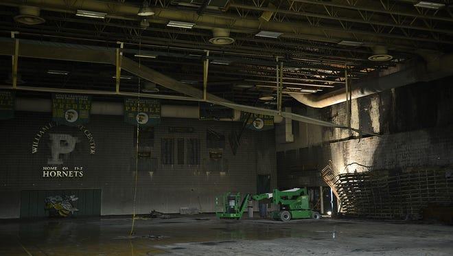 Fire damage inside the main gymnasium at Green Bay Preble High School on Thursday, Aug. 14, 2014.