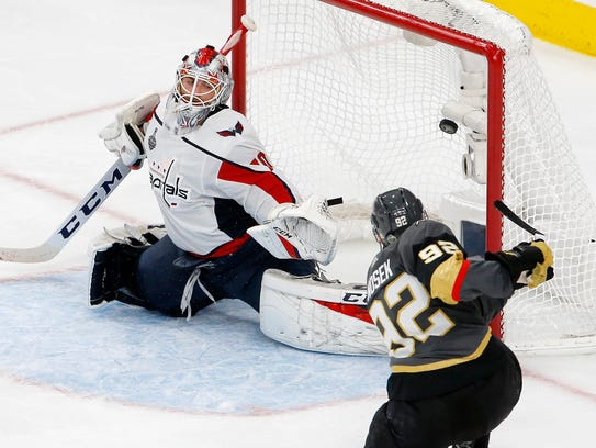 Capitals goaltender Braden Holtby is scored on by Golden Knights left wing Tomas Nosek during the third period in Game 1 on Monday.
