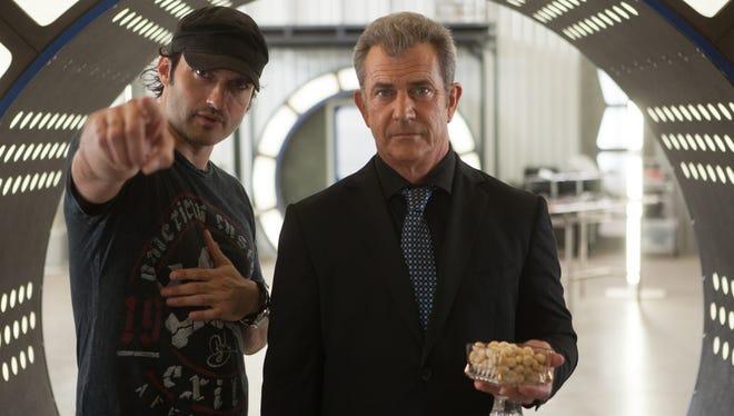 "Director Robert Rodriguez, left, and Mel Gibson on the set of ""Machete Kills."""