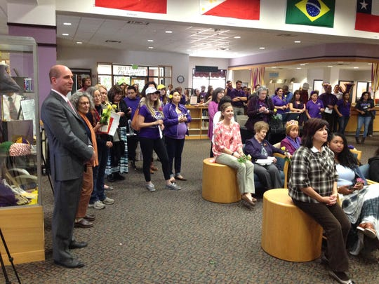 University President Joe Shepard, left, looks on as Western New Mexico University staff and students celebrate the 123rd anniversary of WNMU on Thursday in the Miller Library on campus.