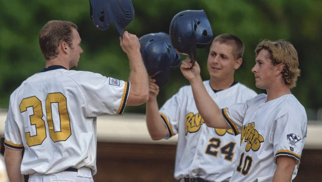 Richmond RiverRats' Brendon Neel, left, is greeted by teammates Justin Paulsen and Kyle Jackson, right after hitting a three run homerun against the West Virginia Miners during a baseball game at McBride Stadium Wednesday, July 16, 2014.