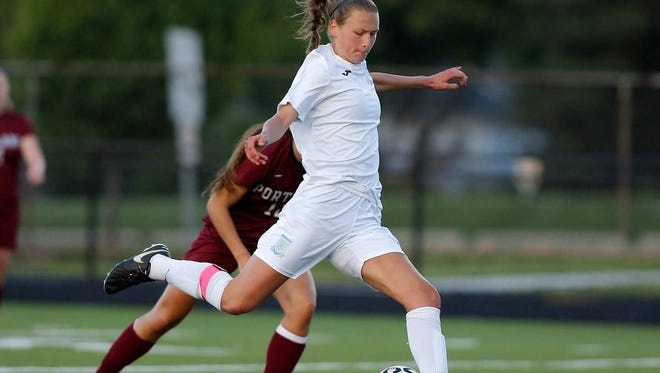 Lansing Catholic's Abigail Gilmore takes a shot against Portland in their district game, Tuesday, May 30, 2017, at Lansing Catholic in Lansing, Mich. Lansing Catholic won 8-0.