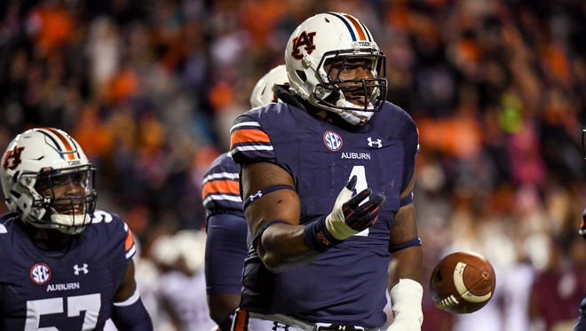 Auburn defensive tackle Montravius Adams celebrates after picking up a deflected pass on Nov 19, 2016.