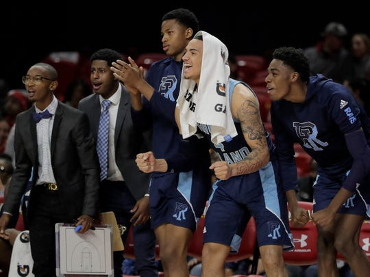 Rhode Island guard Tyrese Martin, second from right, reacts with teammates on the bench during the first half of an NCAA college basketball game against Maryland, Saturday, Nov. 9, 2019, in College Park, Md. (AP Photo/Julio Cortez)