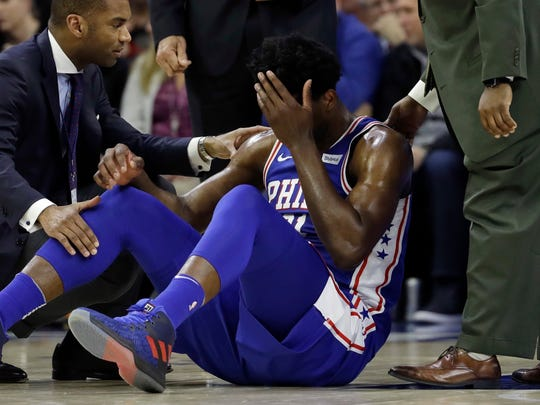 Joel Embiid played just nine minutes before leaving with a facial contusion.
