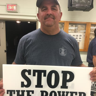 Jan Horst, a Marion farmer, picked up a sign after