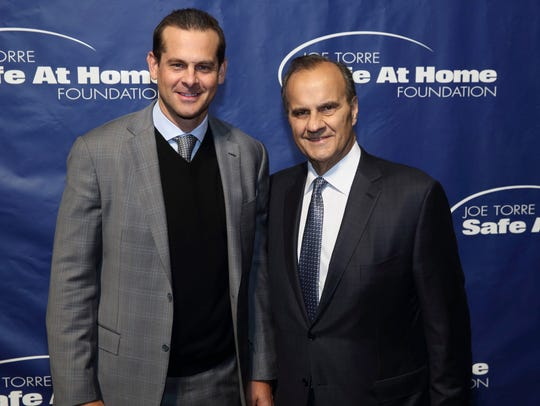 Aaron Boone, left, with former Yankees manager Joe