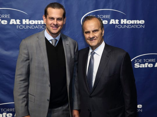 Aaron Boone, left, with former Yankees manager Joe Torre during the Joe Torre Safe At Home Foundation fundraiser in New York in 2013.