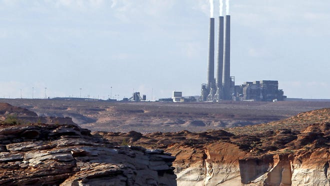 The main plant facility at the Navajo Generating Station is seen Sept. 4, 2011, from Lake Powell in Page, Ariz.