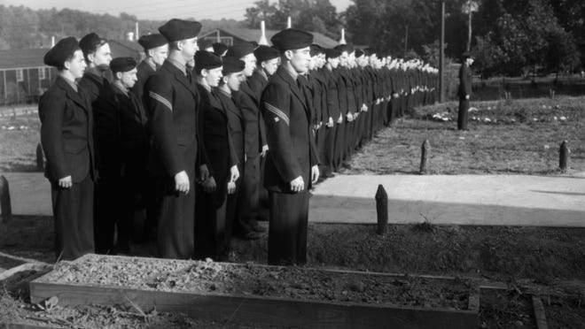 Members of the Civilian Conservation Corps line up for inspection in 1939 at Garrett Park, Missouri, near Washington.