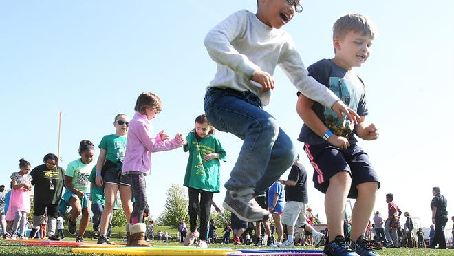 """Topeka Public Schools children play during the May 2019 Unified Field Day at Hummer Sports Park. USD 501 physical education teacher Matt Dunkin recently launched a podcast to share his insights because he says """"every kid has the right to enjoy"""" physical activity."""