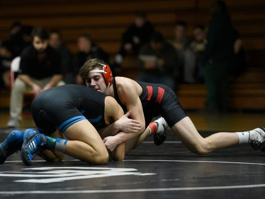 Churchill's Drew Bush (right) takes on Waterford Mott's Darian Lindemier in last year's 135 pound Observerland championship match.