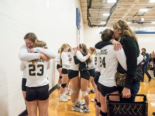 Delone Catholic players embrace after falling in the PIAA 2A state championship against Freeport in Johnstown Nov. 18, 2017.