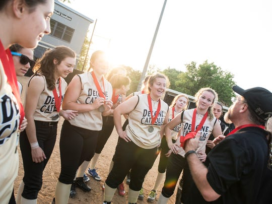 Delone Catholic softball players listen to one of their coaches after receiving their runner-up medals following the District 3 Class 3A championship game against Brandywine Heights at Seaber Softball Stadium in Millersville on May 29, 2018. The Squirettes fell 2-1.