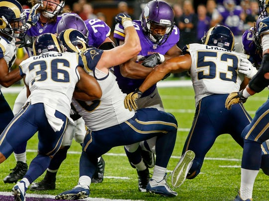 Sep 1, 2016; Minneapolis, MN, USA; Minnesota Vikings running back C.J. Ham (30) rushes for a touchdown against the Los Angeles Rams in the fourth quarter at U.S. Bank Stadium. The Vikings win 27-25. Mandatory Credit: Bruce Kluckhohn-USA TODAY Sports