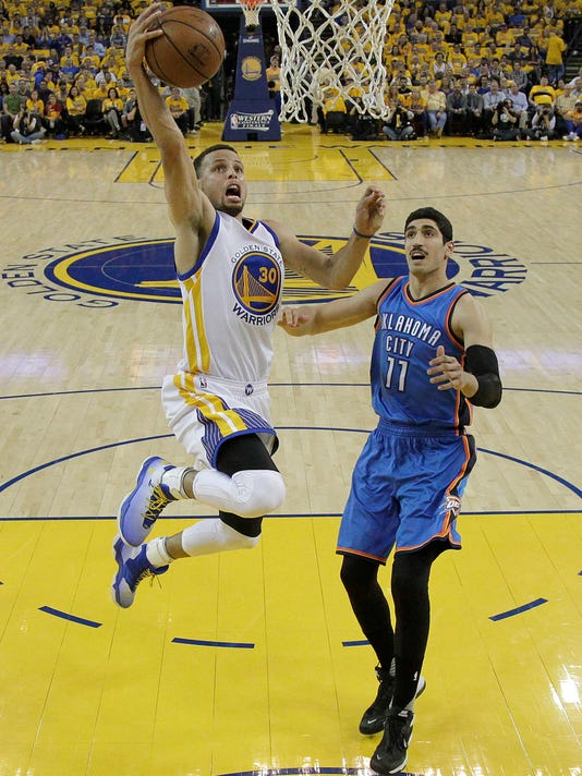 Golden State Warriors guard Stephen Curry (30) shoots against Oklahoma City Thunder center Enes Kanter (11) during the first half of Game 1 of the NBA basketball Western Conference finals in Oakland, Calif., Monday, May 16, 2016. The Thunder won 108-102. (AP Photo/Marcio Jose Sanchez)