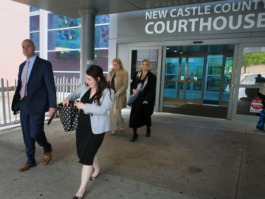 Attorneys for the prosecution leave the New Castle