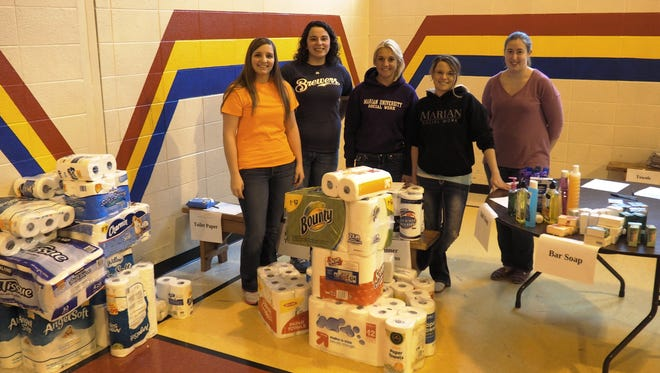 Pictured from left are Marian University students Taylor Wilkens, Kayla Merger, KelAn Schmitt, Danyel Syms and Caitlin Henriksen, who volunteered to receive and sort donated hygiene items.