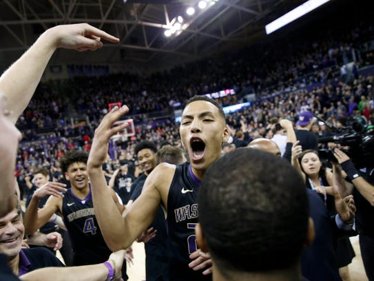 Huskies forward Dominic Green (22) celebrates after