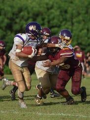 George Washington wide receiver Calvin Aguon (1) avoids