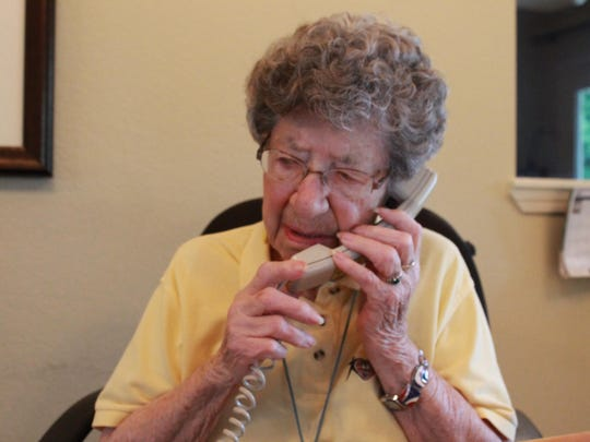 Hazel Schoephoester answers the phone at the Schliemann Center for Women's Health Education on a Thursday morning. Schoephoester, 95, is a volunteer at Baxter Regional and has been for 20 years.