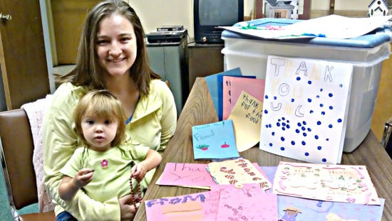 Angela Merrill of Hilton United Methodist and daughter Tea with some of the thank you cards from Summer Playground participants