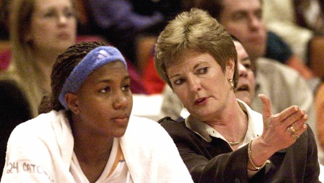 Tennessee head coach Pat Summitt talks with Tamika Catchings during their game against South Carolina Jan. 11, 2001, in Knoxville, Tenn.