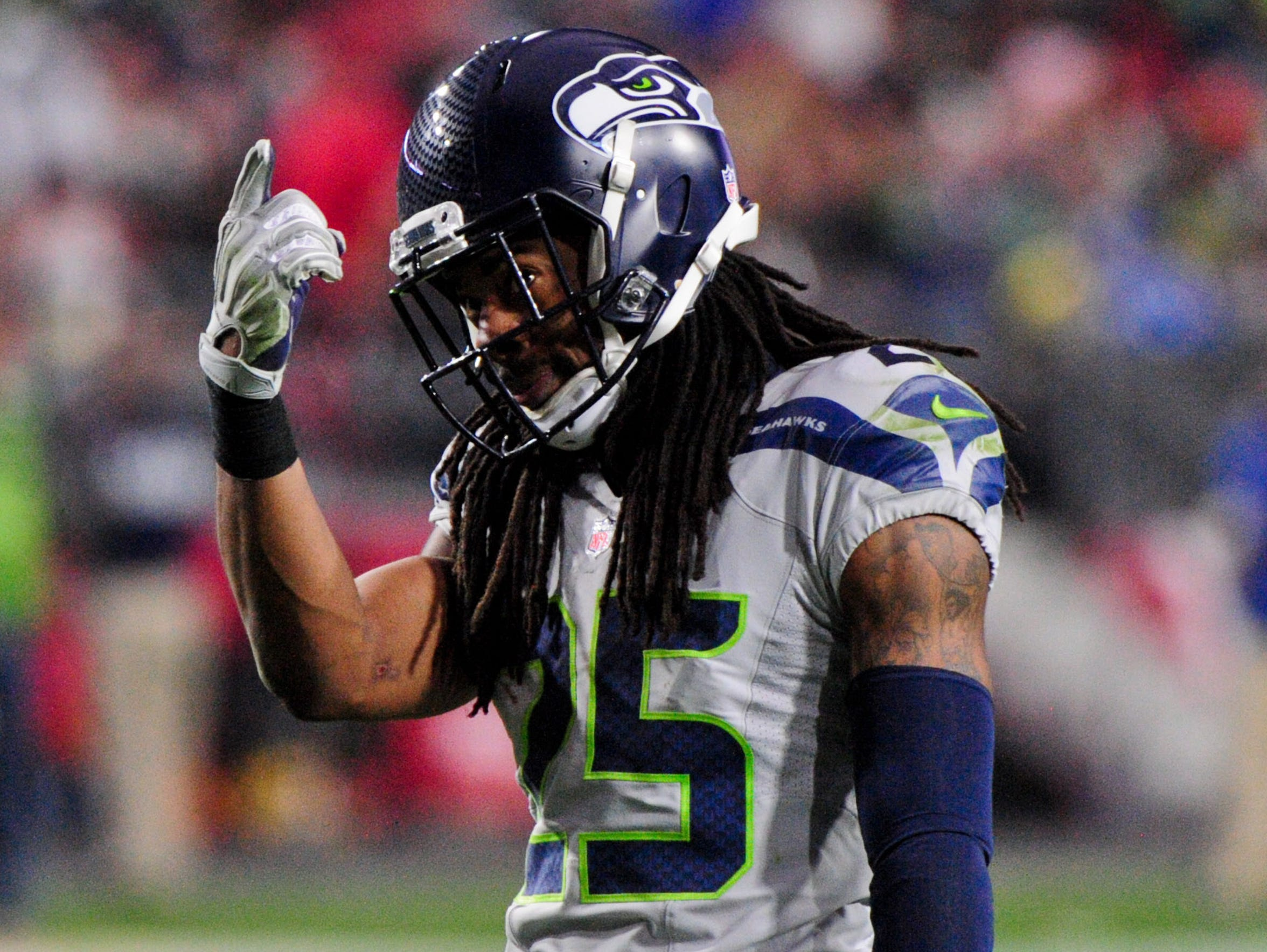 Richard Sherman gestures during a game against the