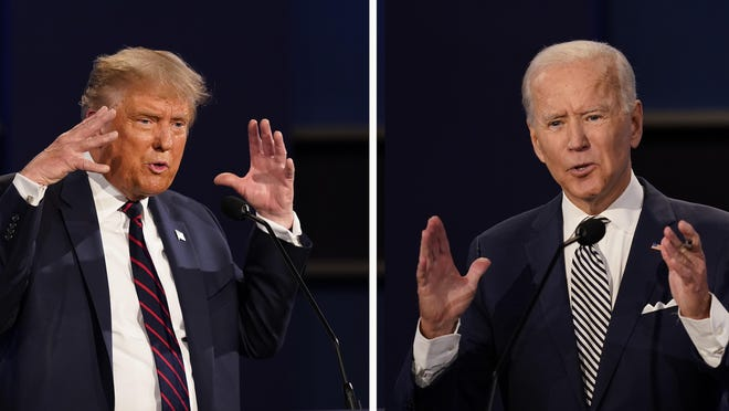 FILE - This combination of Sept. 29, 2020, file photos show President Donald Trump, left, and former Vice President Joe Biden during the first presidential debate at Case Western University and Cleveland Clinic, in Cleveland, Ohio. The Commission on Presidential Debates says the second Trump-Biden debate will be 'virtual' amid concerns about the president's COVID-19.