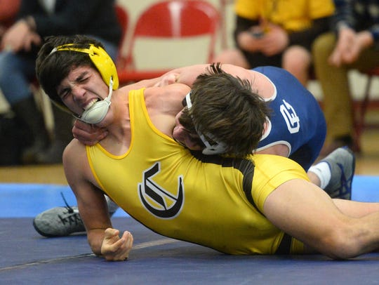 Great Falls High's Chase Perry attempts to pin Capital's