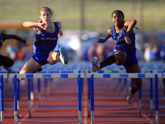 Clear Creek Amana's Natalie Brimeyer, left, and Mia Smith compete in the 100 meter hurdles at the Creek Classic Relays at Clear Creek Amana on Friday.