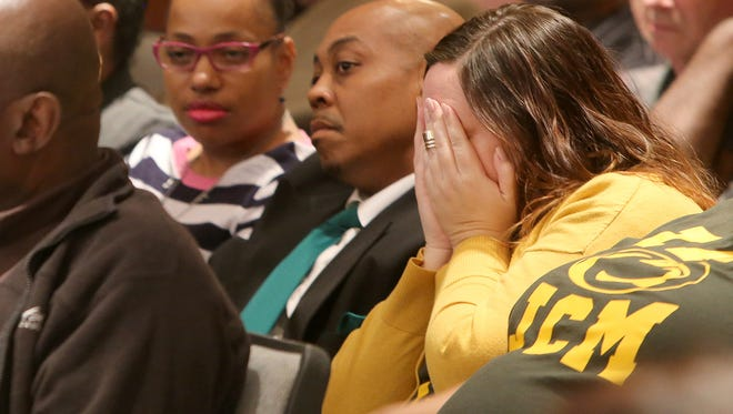 Jackson Central-Merry supporter Kara Reeves covers her face as the school board debates on Vision 2020 during a meeting in the George Smith Room at City Hall on Thursday.