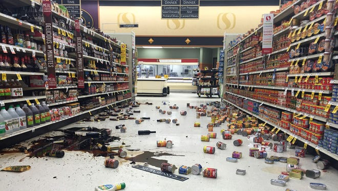 In this photo provided by Vincent Nusunginya, items fallen from the shelves litter the aisles inside a Safeway grocery store following a magnitude 6.8 earthquake on the Kenai Peninsula on Sunday Jan. 24, 2016, in south-central Alaska.