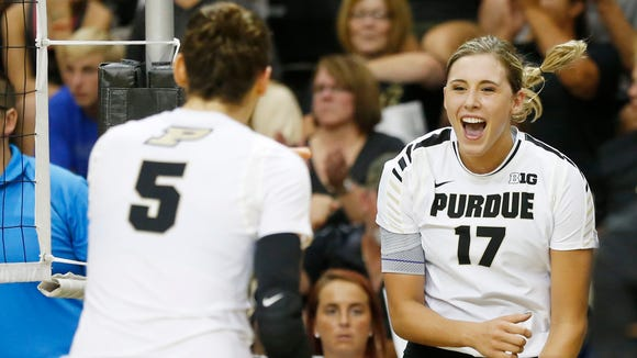 Blake Mohler, right, and Ashley Evans celebrate a Purdue point against Illinois Wednesday, September 21, 2016, in Holloway Gymnasium on the campus of Purdue University. Illinois upset No. 10 Purdue 21-25, 25-20, 25-23, 25-27, 15-11.