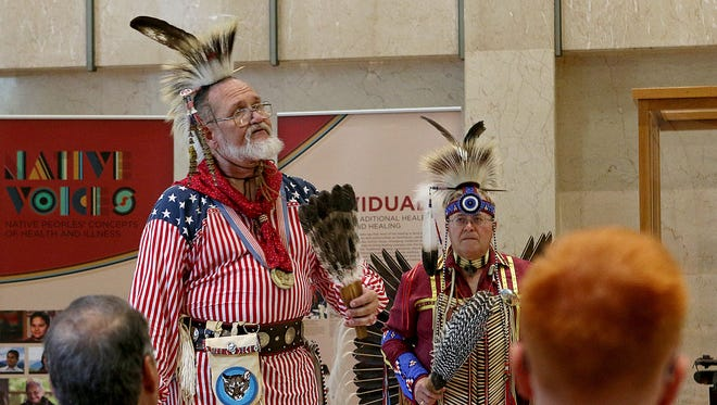 Don Jensen of the Red River Intertribal Club shares a bit of his story during the closing presentation of the Native Voices exhibit Sunday afternoon at the Moffett Library.