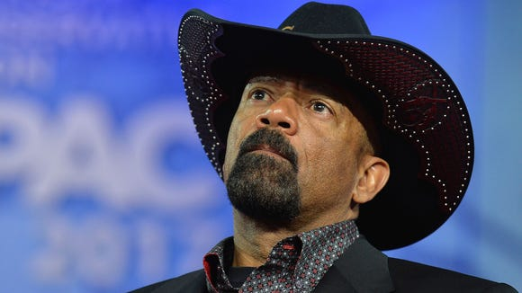 Milwaukee County Sheriff David A. Clarke, Jr. listens