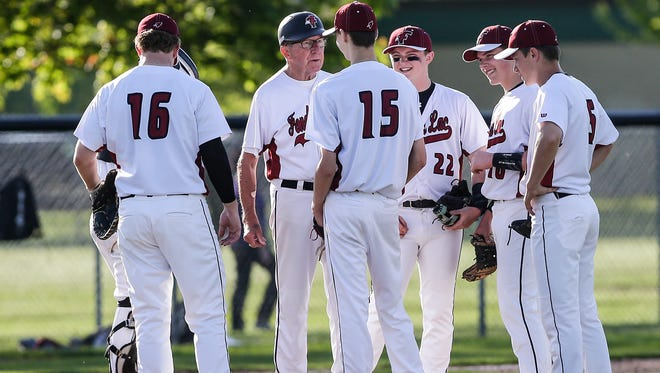 Fond du Lac baseball coach Marty Paulsen talks to pitcher Caden Krug during a 2018 game against Appleton East. The Cardinals are headed to the state tournament for the first time since 2000.