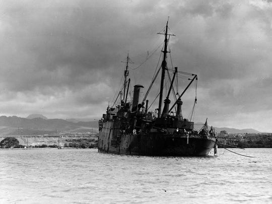 The USS Vestal beached in Pearl Harbor after its crew