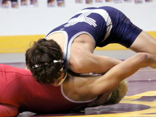 Silver's Zeke Marquez squeezes his Cobre opponent in