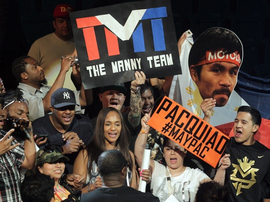 """Fans show their support for boxers Manny Pacquiao and Floyd Mayweather  at the weigh-in on May 1, 2015 in Las Vegas, one day before their """"Fight of the Century"""" on May 2 at the MGM Grand Garden Arena."""